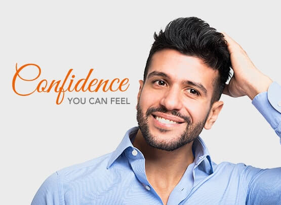 Stock image of a male model feeling happy and confidence by touching hair