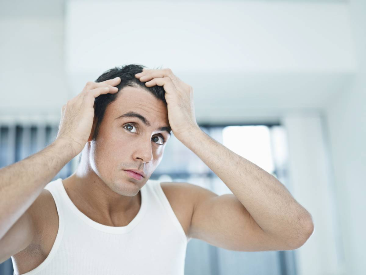 Man looking for signs he is not going bald.